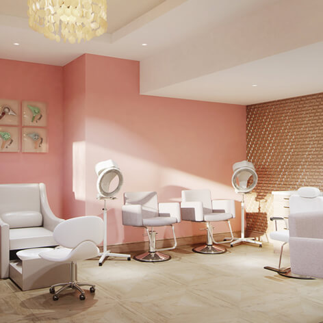Heartis Buckhead's Brighton Salon and Spa with pink walls, salon chairs and décor