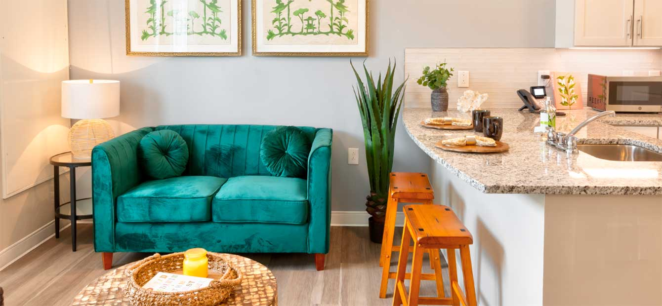 Heartis Venice apartment with love seat and stool seating at the kitchen counter